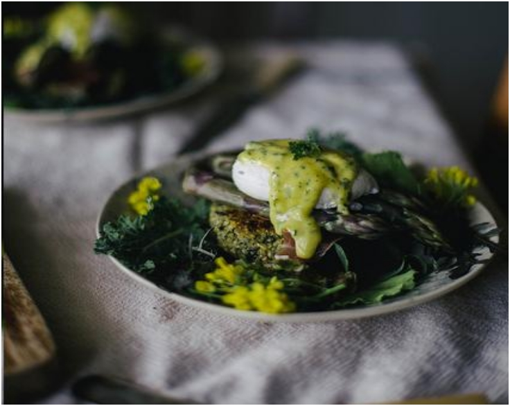 asparagus benedict on quinoa nettle cakes with lovage mint aiol